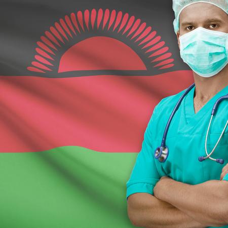 malawian flag: Surgeon with flag on background - Malawi