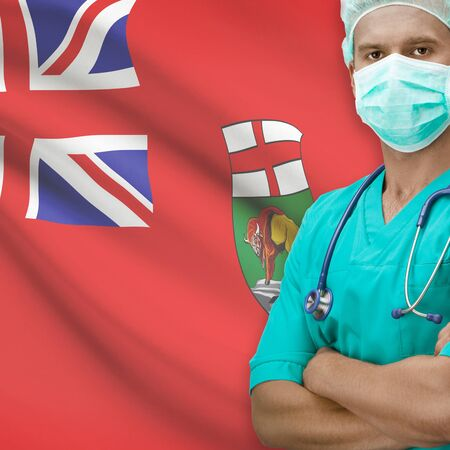 manitoba: Surgeon with Canadian province flag on background - Manitoba