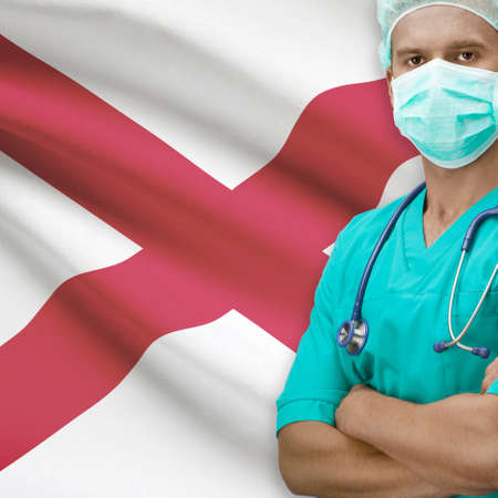 Surgeon with USA states flags on background - Alabama Stock Photo