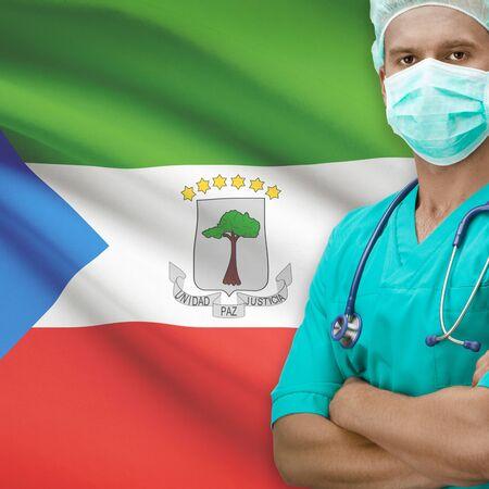 equatorial guinea: Surgeon with flag on background - Equatorial Guinea