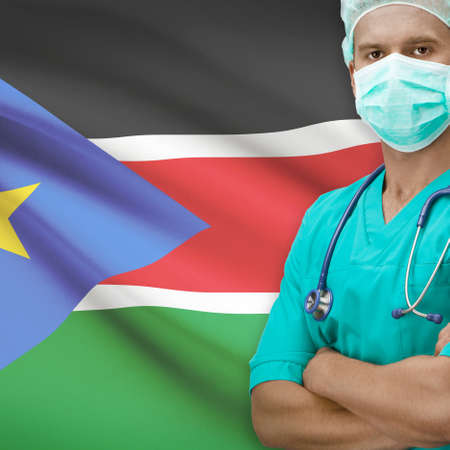 south sudan: Surgeon with flag on background - South Sudan
