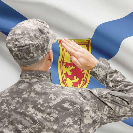 nova scotia: Soldier saluting to Canadial province flag conceptual series - Nova Scotia