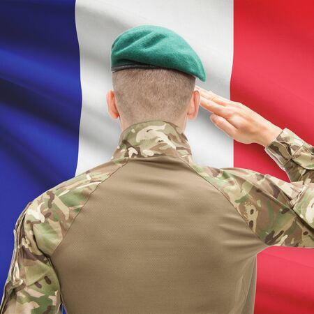 patriot: Soldier in hat facing national flag series - France