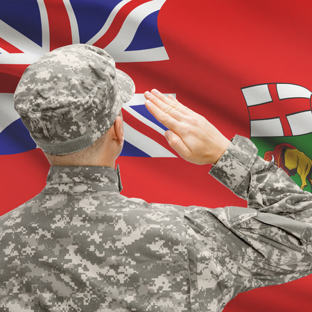 manitoba: Soldier saluting to Canadial province flag conceptual series - Manitoba
