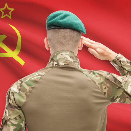 soviet flag: Soldier in hat facing national flag series - USSR - Soviet Union