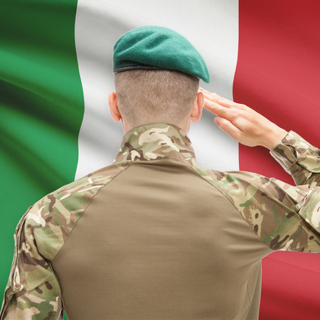 sovereignty: Soldier in hat facing national flag series - Italy