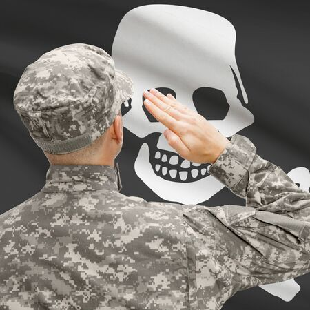 jolly roger: Soldier saluting to USA state flag conceptual series - Jolly Roger Stock Photo