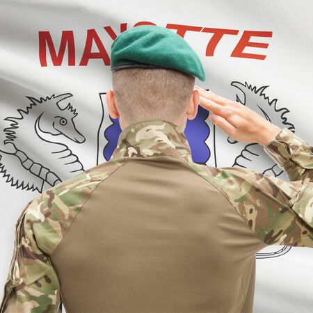 mayotte: Soldier in hat facing national flag series - Mayotte