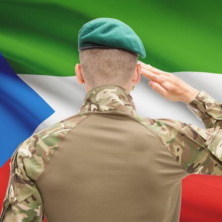 equatorial guinea: Soldier in hat facing national flag series - Equatorial Guinea