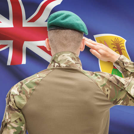 the turks: Soldier in hat facing national flag series - Turks and Caicos Islands Stock Photo