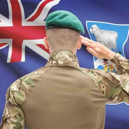 falkland: Soldier in hat facing national flag series - Falkland Islands