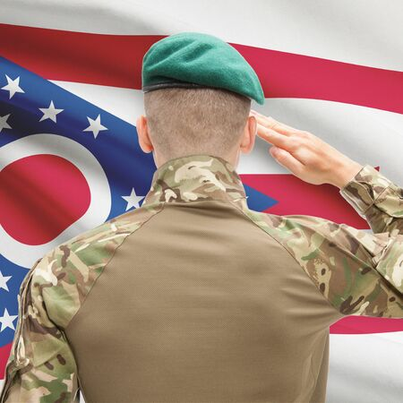strong base: Soldier saluting to US state flag series - Ohio Stock Photo