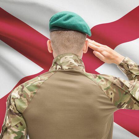 alabama flag: Soldier saluting to US state flag series - Alabama