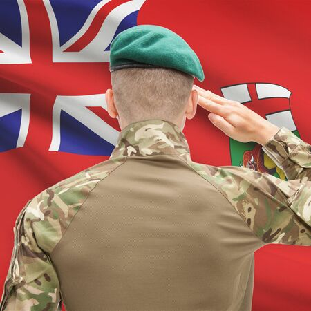 manitoba: Soldier saluting to Canadial province flag series - Manitoba