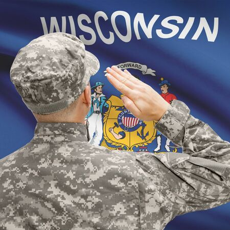 wisconsin flag: Soldier saluting to USA state flag conceptual series - Wisconsin Stock Photo