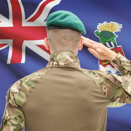cayman islands: Soldier in hat facing national flag series - Cayman Islands Stock Photo