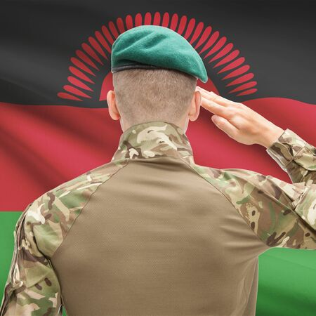 malawian flag: Soldier in hat facing national flag series - Malawi