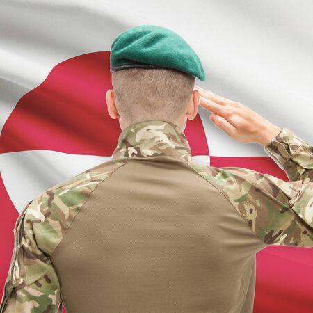 greenlandic: Soldier in hat facing national flag series - Greenland