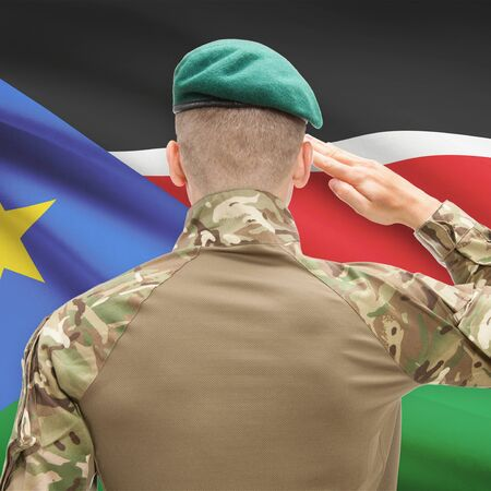 south sudan: Soldier in hat facing national flag series - South Sudan