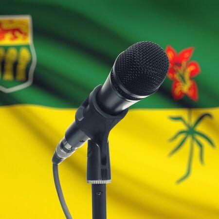 saskatchewan flag: Microphone with Canadian province flag on background series - Saskatchewan