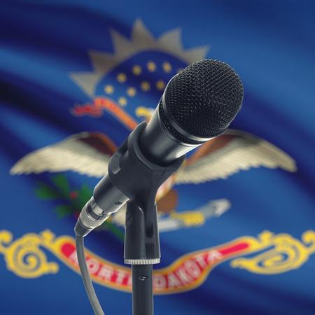 north dakota: Microphone with US states flags on background series - North Dakota