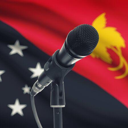 Nuova Guinea: Microfono con bandiera nazionale su sfondo serie - Papua Nuova Guinea
