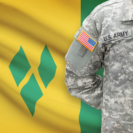 grenadines: American soldier with flag on background series - Saint Vincent and the Grenadines Stock Photo