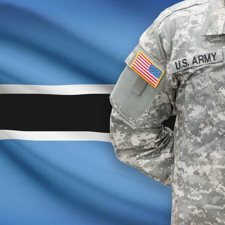 botswanan: American soldier with flag on background series - Botswana Stock Photo