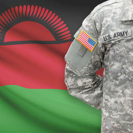 malawian flag: American soldier with flag on background series - Malawi Stock Photo