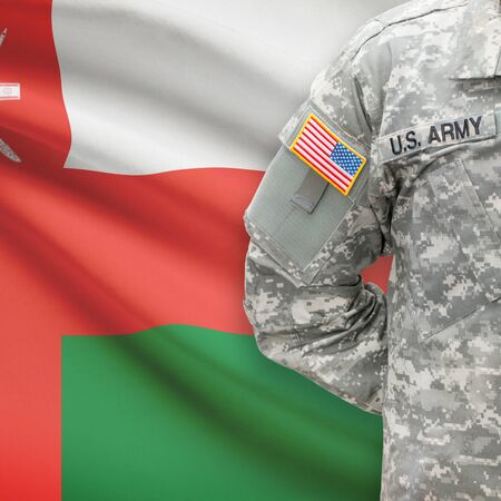 oman background: American soldier with flag on background series - Oman Stock Photo