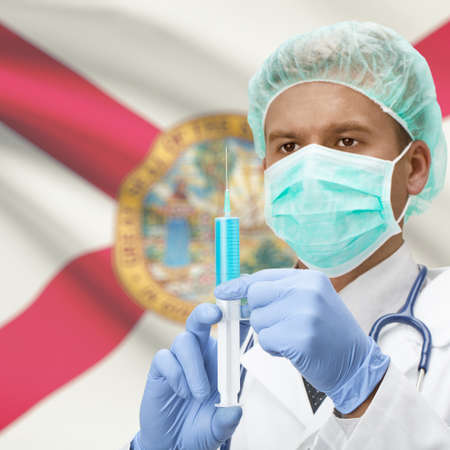 floridian: Doctor with syringe in hands and USA states flags on background series - Florida