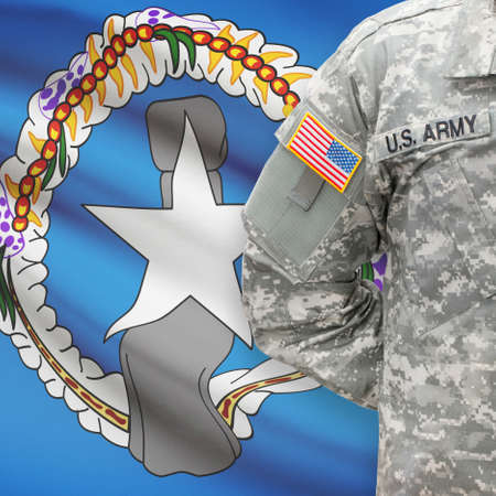 commonwealth: American soldier with flag on background series - Commonwealth of the Northern Mariana Islands Stock Photo