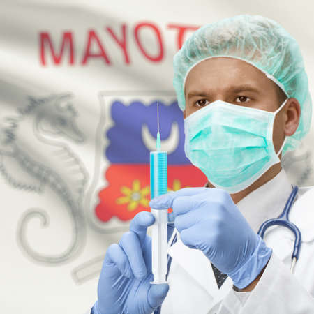 mayotte: Doctor with syringe in hands and flag on background series - Mayotte