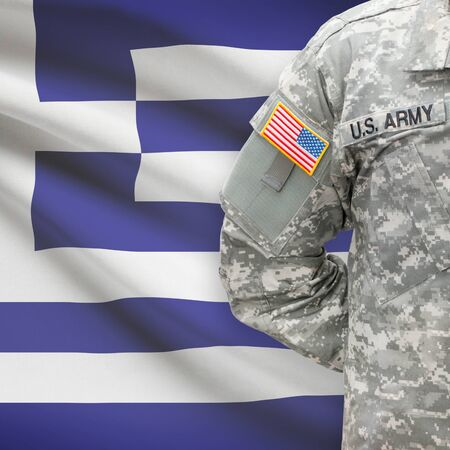 hellenic: American soldier with flag on background series - Greece - Hellenic Republic Stock Photo