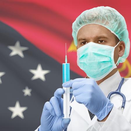 new guinea: Medico con la siringa in mano e bandiera su sfondo serie - Papua Nuova Guinea