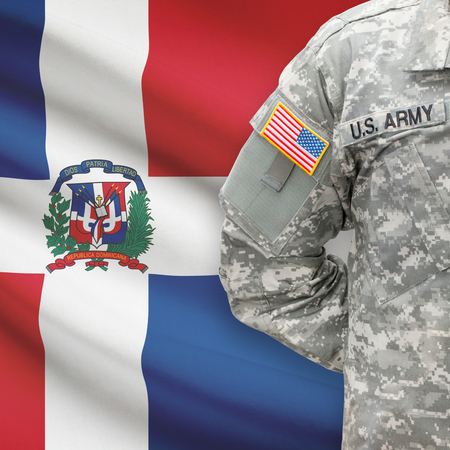 American soldier with flag on background series - Dominican Republic