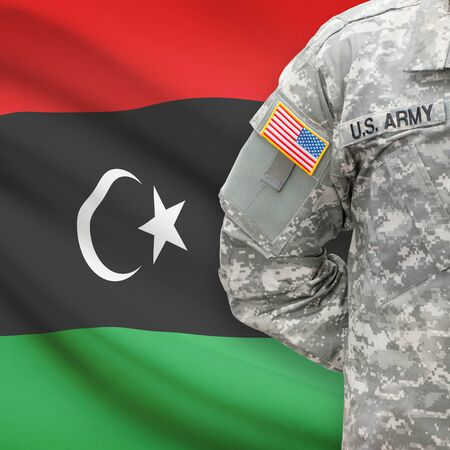 libyan: American soldier with flag on background series - Libya Stock Photo
