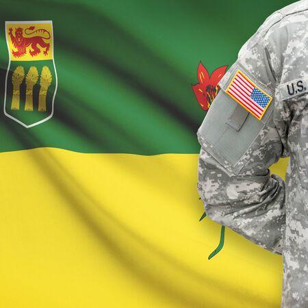 saskatchewan: American soldier with Canadian province flag on background series - Saskatchewan