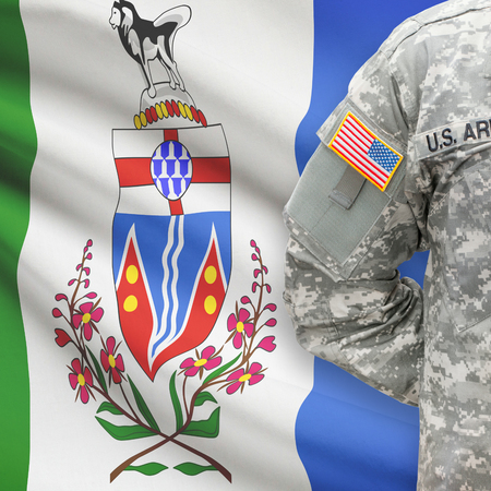 american hero: American soldier with Canadian province flag on background series - Yukon