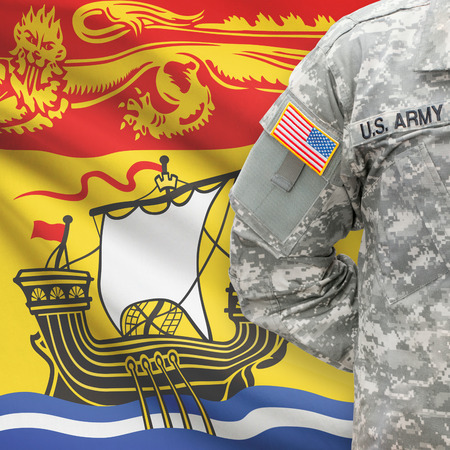 American soldier with Canadian province flag on background series - New Brunswick Stock Photo