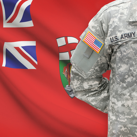 american hero: American soldier with Canadian province flag on background series - Manitoba Stock Photo