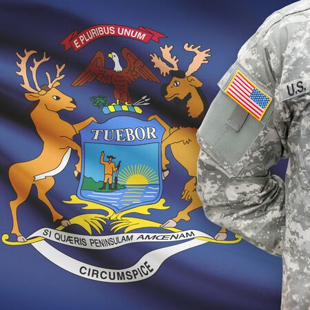 michigan flag: American soldier with US state flag on background series - Michigan