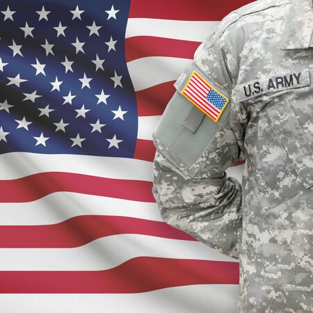 army uniform: American soldier with flag on background series - United States Stock Photo