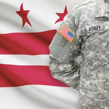 district of colombia: American soldier with US state flag on background series - Washington, D.C. - District of Columbia