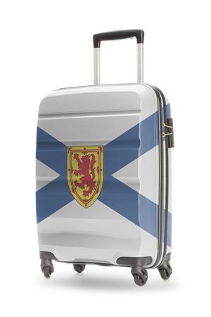 nova scotia: Suitcase painted into Canadian territory or province flag series - Nova Scotia Stock Photo