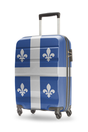 province: Suitcase painted into Canadian territory or province flag series - Quebec Stock Photo