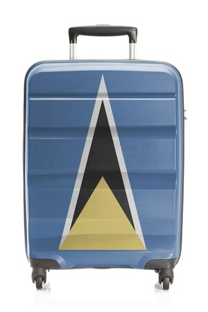 lucia: Suitcase painted into national flag series - Saint Lucia Stock Photo
