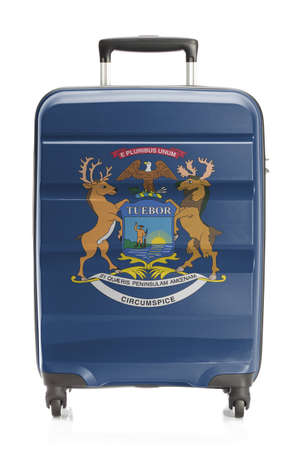 michigan flag: Suitcase painted into US state flag series - Michigan Stock Photo