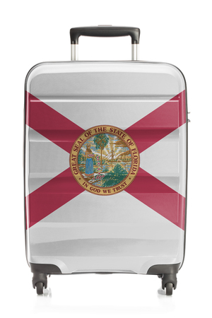 floridian: Suitcase painted into US state flag series - Florida Stock Photo