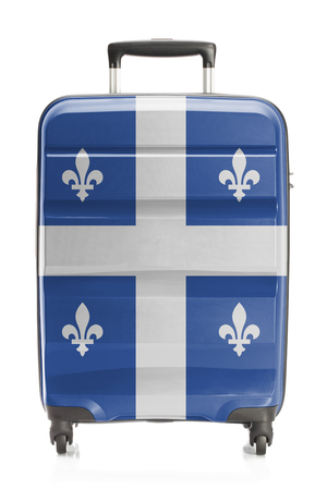 Suitcase painted into Canadian territory or province flag series - Quebec 写真素材